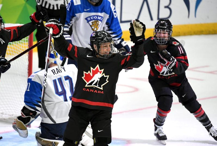 Halifax's Jill Saulnier, right, celebrates a goal by Canadian teammate Rebecca Johnston in a 6-1 win over Finland at the IIHF women's world hockey championship on Tuesday.
