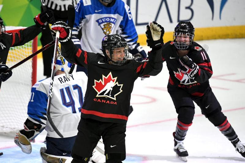 Halifax's Jill Saulnier, right, celebrates a goal by Canadian teammate Rebecca Johnston in a 6-1 win over Finland at the IIHF women's world hockey championship. - Reuters