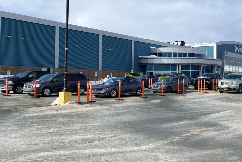 Cars line up outside the drive-thru COVID-19 testing facility outside the Reid Community Centre in Mount Pearl. With the backlog of tests addressed, Eastern Health has closed the Mount Pearl Senior High test facility for the time being.