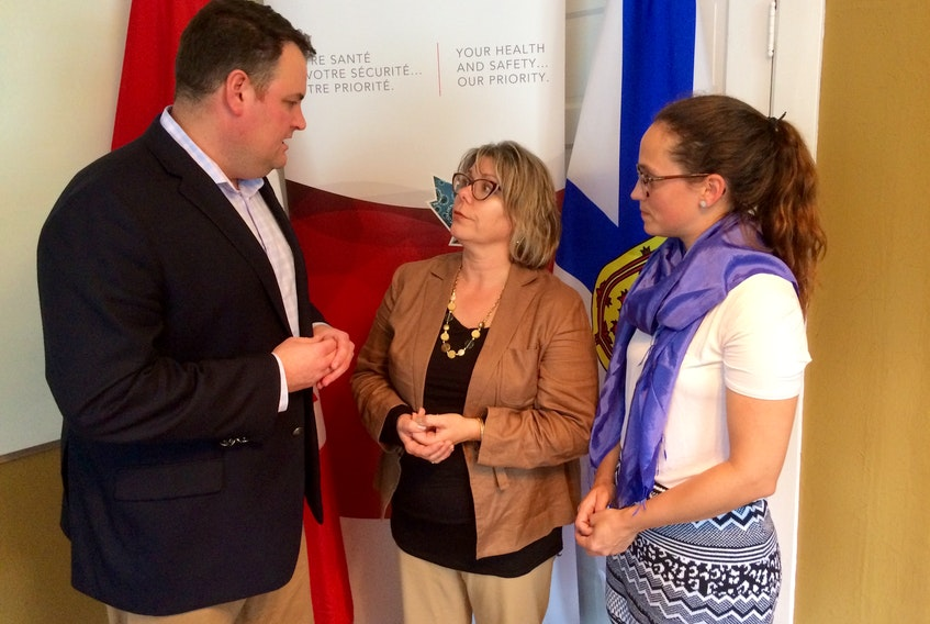 West Nova MP Colin Fraser, Joan Donaldson and Lisanne Turner at the Tri-County Women's Centre on Thursday, Oct. 11. Turner is the women's centre's executive director. Donaldson is project co-ordinator for the centre's Cannabis Education and Substance User Support program.