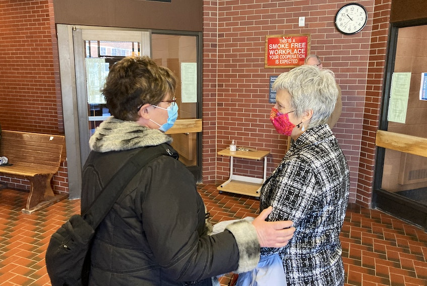 Karin Robertson, right, speaks to a supporter in Kentville provincial court after being acquitted of charges under the Animal Protection Act on Wednesday.
