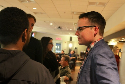Conservative Egmont Candidate Logan McLellan chats with a supporter during Tuesday night's election results party in Summerside. McLellan finished second behind Liberal incumbent Bobby Morrissey.