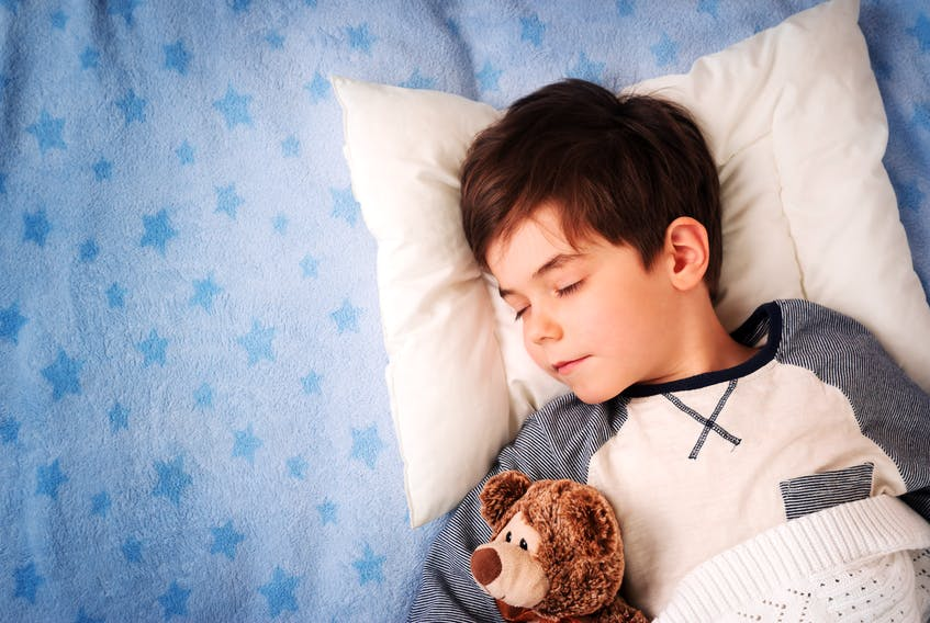 Over the last century, children are sleeping about an hour less a night, researchers say. - File