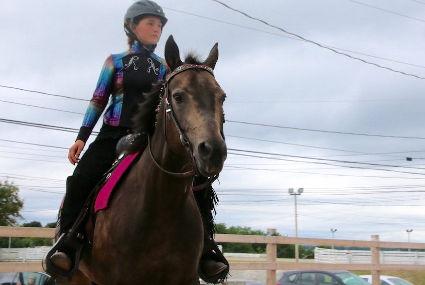 Alison White rode Lace (Simply Bar) in the 4-H junior western pleasure class at the NSPE grounds during the exhibition's 4-H day. Alison, 12, is a member of the Truro-North River 4-H Club.