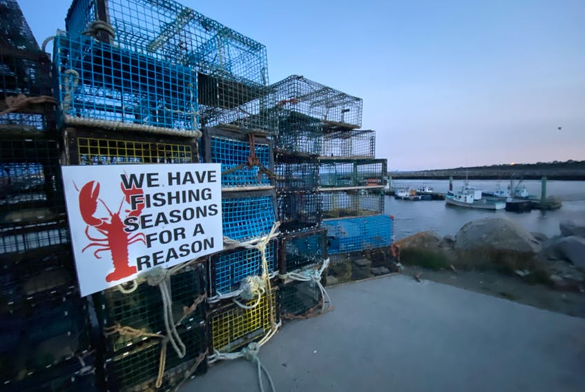 Lobster traps block access onto the wharf in Saulnierville, Digby County on the morning of Sept. 15 as commercial lobster fishermen protested what they call DFO inaction when it comes to enforcement of illegal out-of-season commercial lobster sales that they say happens every summer in St. Mary's Bay. TINA COMEAU PHOTO