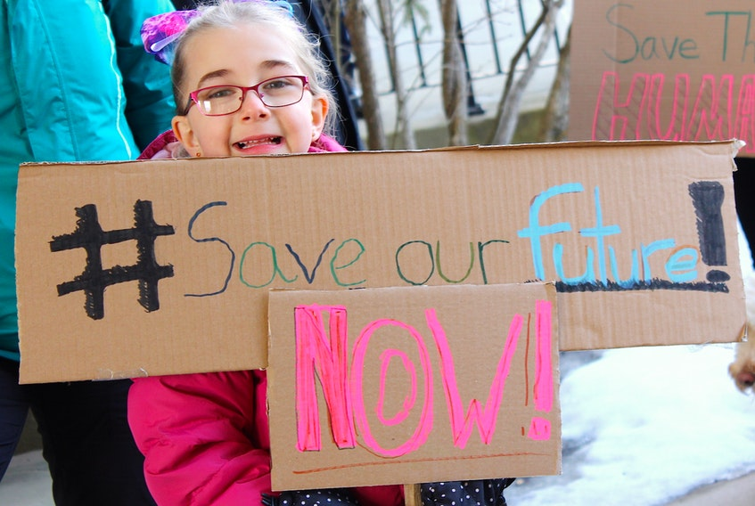 Sackville students of all ages took part in Friday's climate strike, including Chloe Roness-Allen who used a handmade cardboard sign to make her plea.