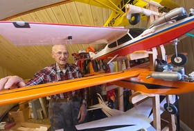 96-year-old Yarmouth County resident Roland Bourque, also a Second World War veteran, stands with some of his model airplanes in his home. He's been fascinated by planes since he was a kid, starting making model planes before he was a teenager and still builds them now. TINA COMEAU PHOTO