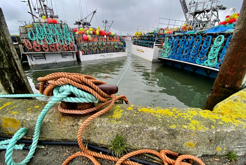 Lobster vessels tied to the wharf in Pinkney's Point, Yarmouth County, on Sunday, Dec. 6, as captains and crews continued to await word on when the season will get underway. Weather had postponed the start since it was cancelled on Nov. 30. TINA COMEAU PHOTO
