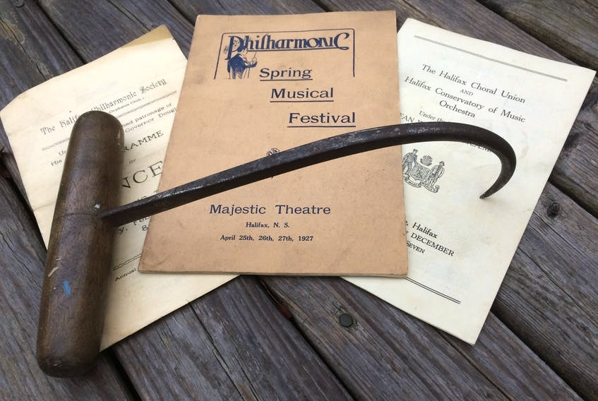 Michael Driscoll Coolen's cargo hook displayed with concert programmes that list him as an orchestra member.