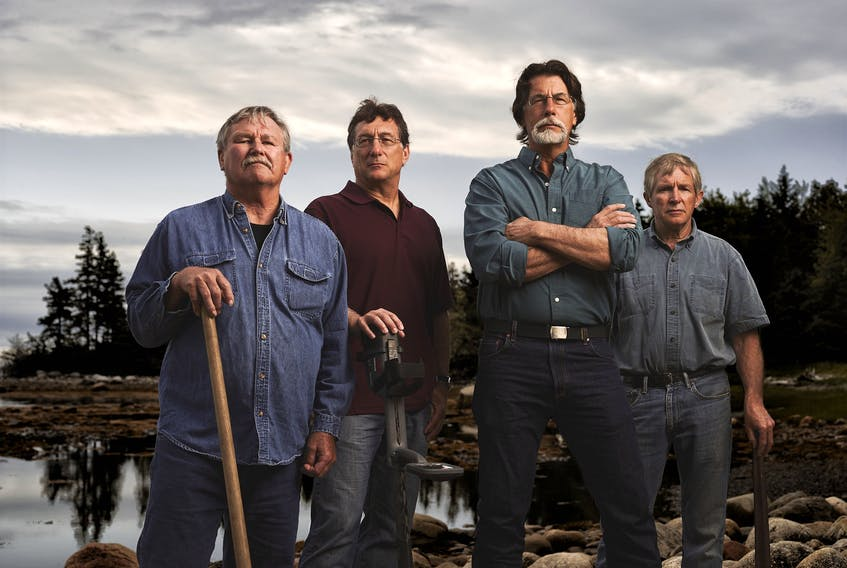 From left, David Blankenship, Marty Lagina, Rick Lagina, and Craig Tester star in The Curse of Oak Island. The new 13-episode season begins Sunday at 11 p.m. on History.  - History Channel