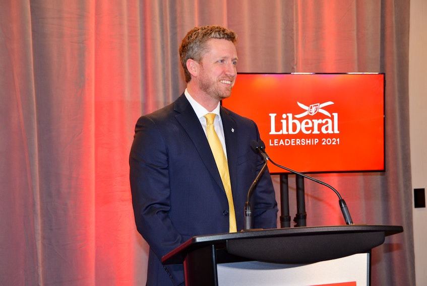 Iain Rankin speaks with media after being named the new leader of the Liberal party of Nova Scotia at the Halifax Convention Centre on Saturday, Feb. 6.