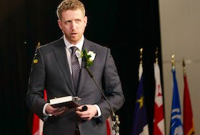 Premier Iain Rankin recites his oath of office Tuesday, Feb. 23, at the Halifax Convention Centre. Communications Nova Scotia