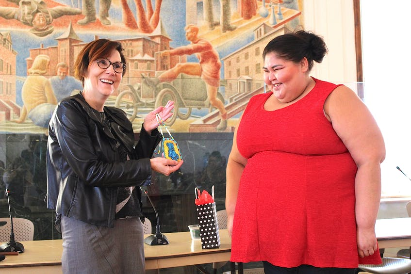 In this file photo, Indigenous children's rights advocate Cindy Blackstock (left) is presented with a special gift from Leona Simon of Elsipogtog First Nation after delivering the keynote address at Mount Allison's Indigenous Day of Learning and Language. — SaltWire file photo/Katie Tower