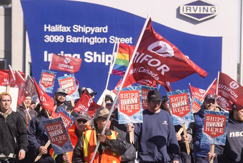 Unifor members march from the Halifax Shipyard to Grand Parade to support the Ships Stay Here campaign on Tuesday afternoon.