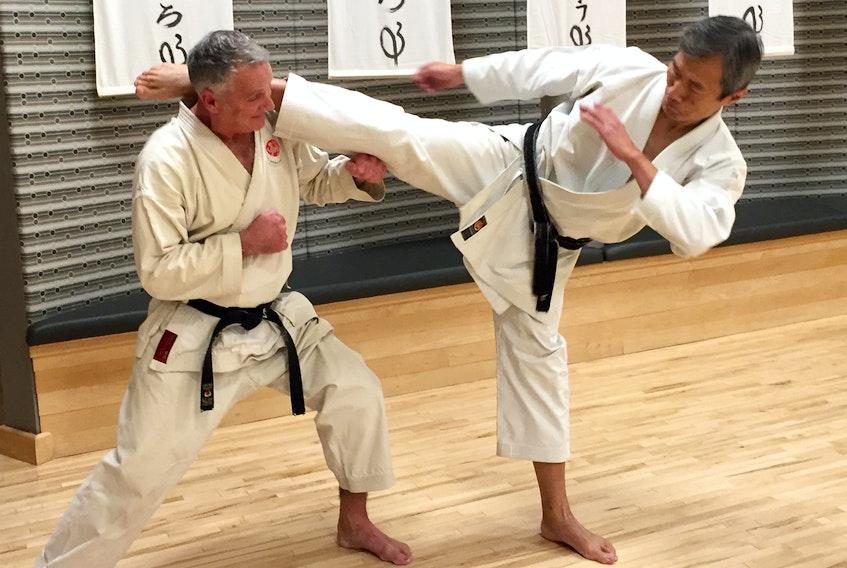 John DeMont gets a close-up view of eight-degree karate black belt Tony Tam's mawashi geri.