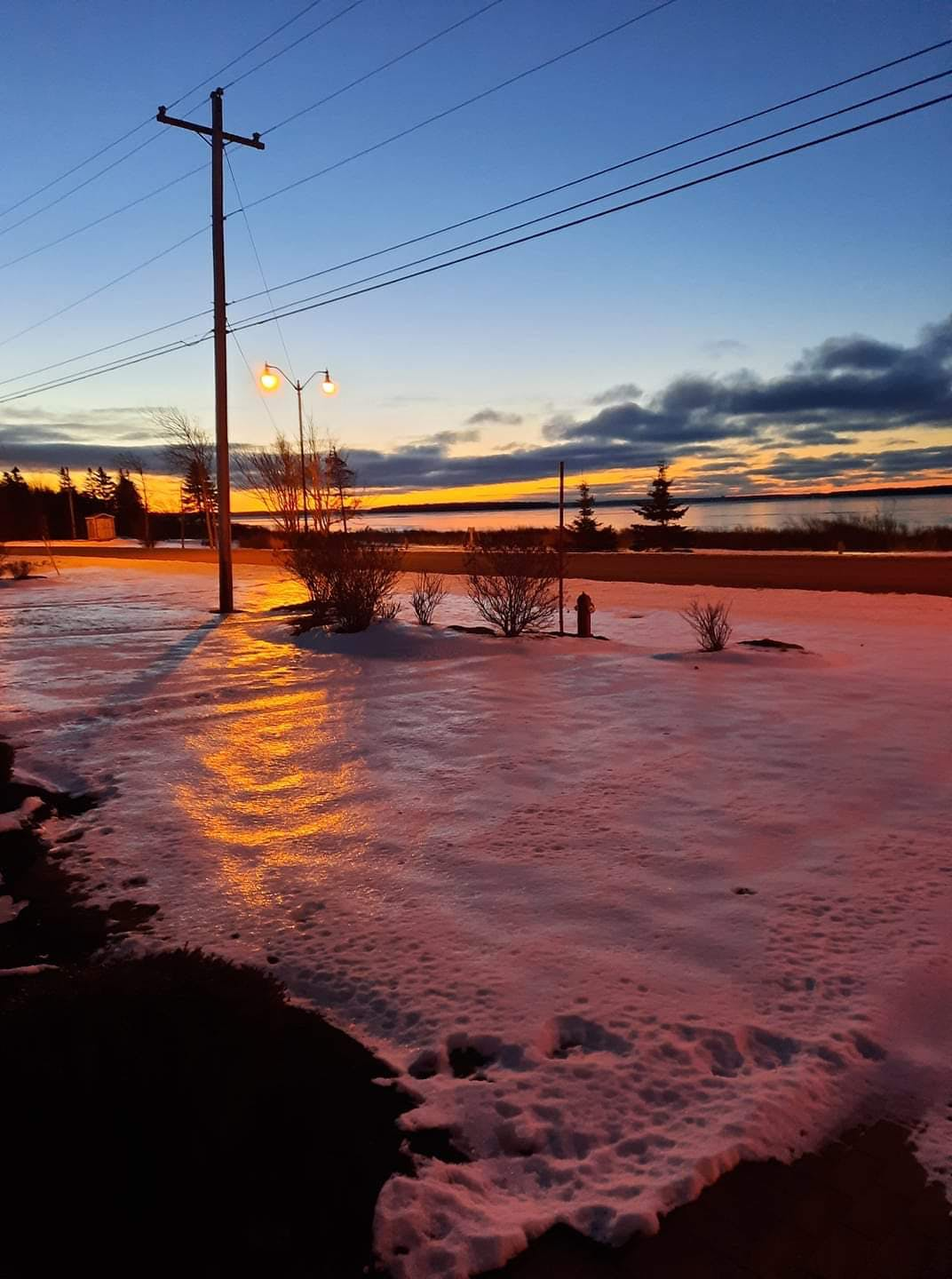 Chris Pharo was so impressed by the photo his wife, Cathy, took last week that he wanted to share it with everyone.  The Pharo's have a great view of the Summerside Harbour from their front porch. The colours that morning were staggering. Where did the foam come from? It's just snow with some magic from the early morning light.