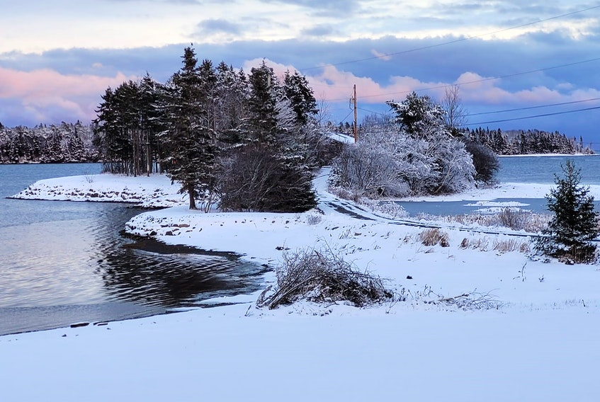 It's a little out of the way but worth the drive to Lower Rose Bay, N.S.  Lynn and Walter Wertz didn't have far to go - this was the view from their living room last Saturday.  The soft pastel shades on the snow and in the clouds were truly magical. Mother Nature might have been showing off for the Wertz's friend, Val, who was visiting on the weekend.
