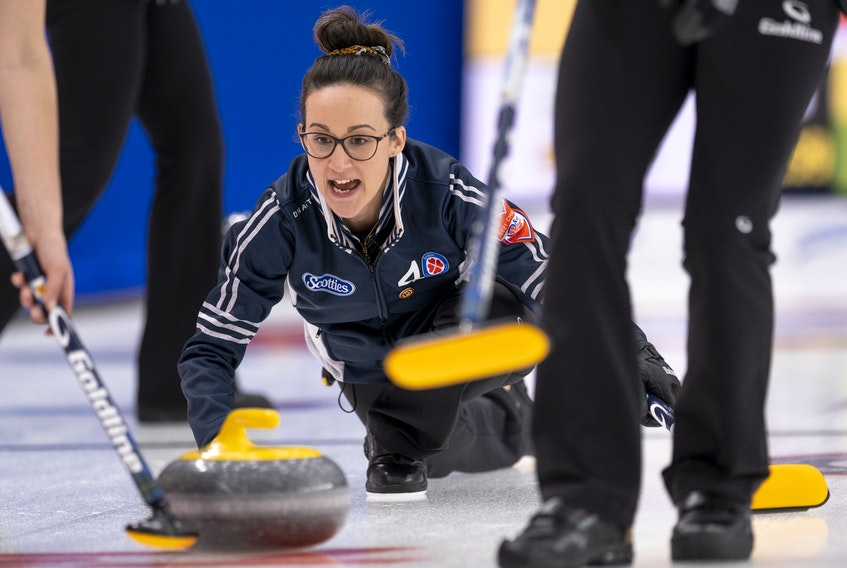 Nova Scotia skip Jill Brothers yells sweeping instructions as she releases her rock during action at the Scotties Tournament of Hearts in Calgary. - Andrew Klaver
