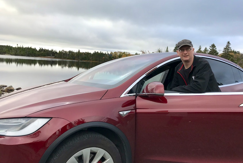 Jon Seary from Portugal Cove-St. Philip's, N.L., has been driving the Tesla Model X SUV for four years and says the performance and cost savings have surpassed his expectations. Although he purchased the vehicle without any subsidies, he argues in favour of rebates for electric vehicle purchases.