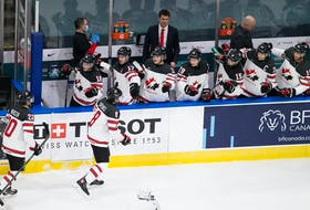 Cornwall's Jordan Spence celebrates his goal Sunday against Slovakia with teammates during Canada's second game at the world junior hockey championship in Edmonton.