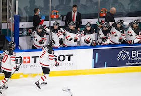 Jordan Spence celebrates with Canadian teammates after scoring against Slovakia at the world junior hockey championship in Edmonton.