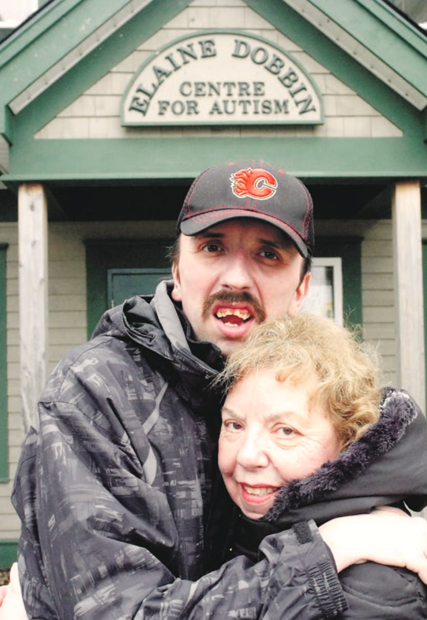 Joyce Churchill, former head of the Autism Society of Newfoundland and Labrador, stands with her son Stephen outside the Elaine Dobbin Centre for Autism. Stephen was diagnosed with autism when he was five.