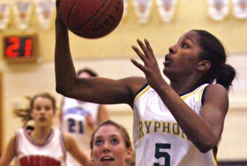 Halifax Grammar School's Justine Colley drives to the basket during a game against Charles P. Allen in 2007.