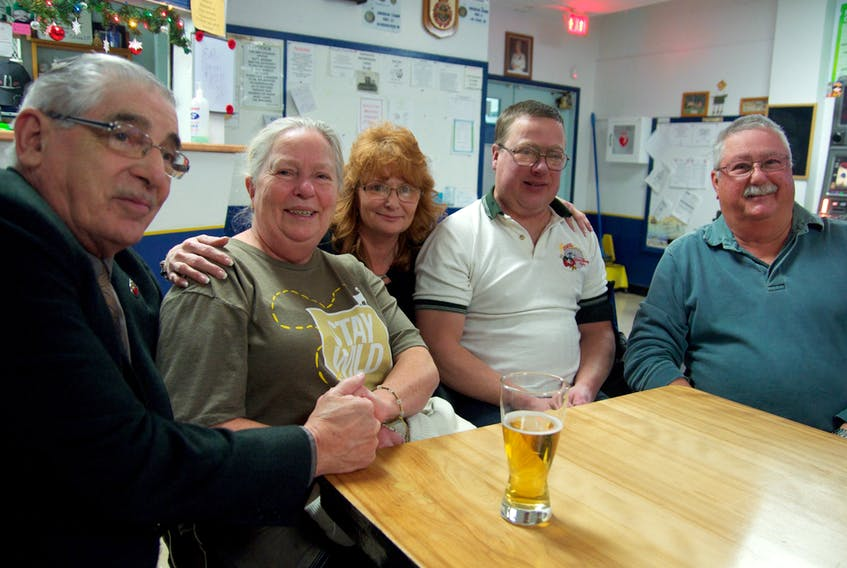 BJ Wile, Maria Kendall, Shelly Meister, Steven Kendall and Gilbert Kendall huddle together at the most popular spot in the legion, known to all as the Family Table. Maria and Gilbert traveled from Las Vegas to Summerside to visit their son, Steven, for Christmas and New Years' Day.