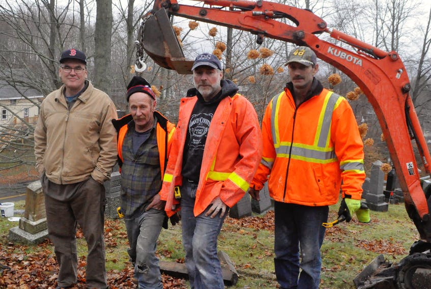 From left: Willowbank manager Chris Fuller stands with Heritage Memorials crew members Andrew Benedict, Chip Peterson and Donnie Nelson, who worked Dec. 1 to restore each gravestone. Not pictured: Jeff Nelson also helped restore the stones.