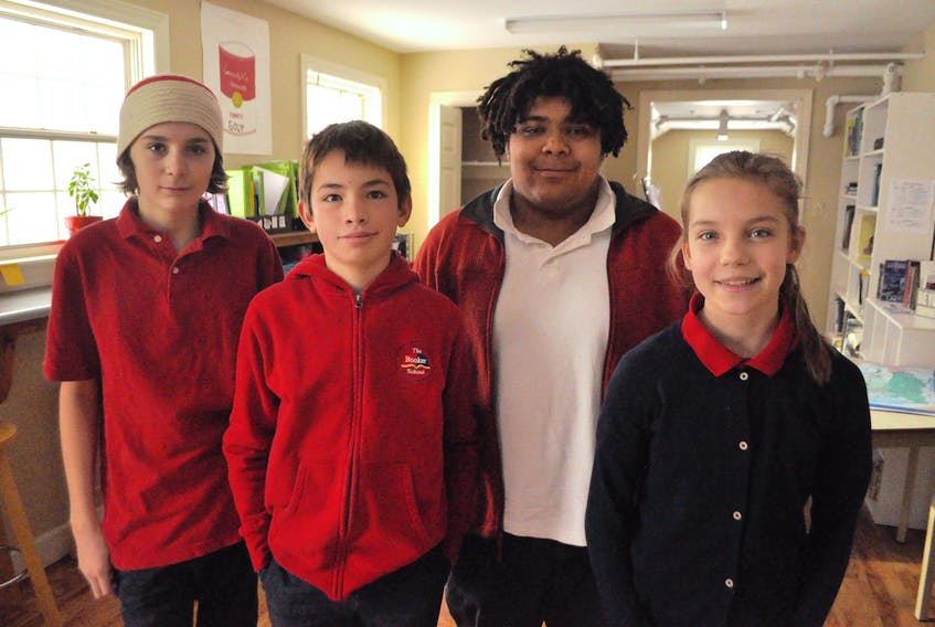 From left: Henry Mulherin, Forrest Robinson, Will Mercer and Hana Hutchinson, four of the Booker School students who came up with a unique solution to the imposing Cornwallis Statue, which stood atop a pedestal until temporarily removed Jan. 31 in Halifax.