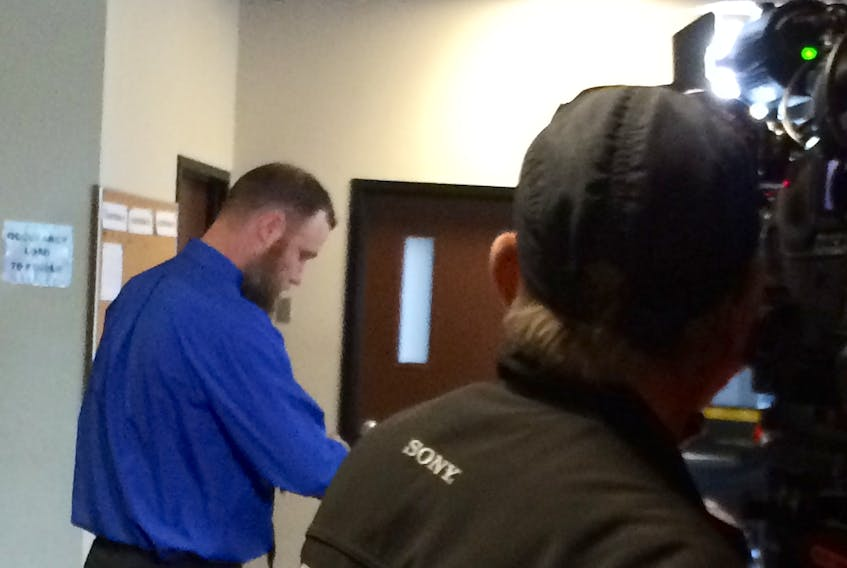 Northeast Kings Education Centre (NKEC) teacher David Harrison goes through security on his way into Kentville provincial court on May 30. He pleaded guilty to a charge of sexual exploitation.