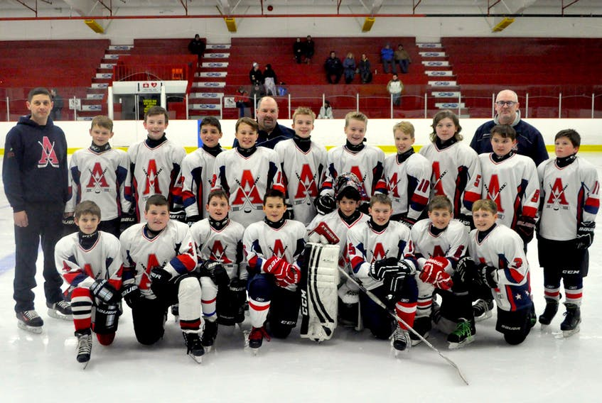 Kentville's peewee C1 team, with coach Joe MacDonald standing in the middle of the back row, will soon enter the Chevrolet Good Deeds Cup competition, which will select ten finalist teams from across Canada based on the good deeds they've done in their communities.