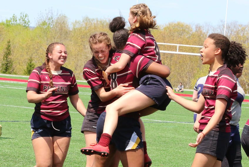 Citadel senior girls react to winning the semi-final bout June 1 to advance to the provincial rugby finals.
