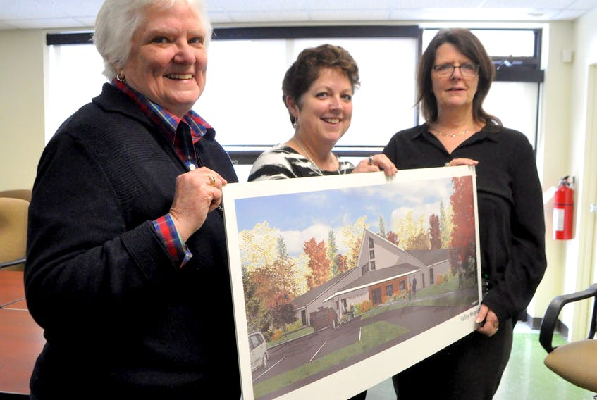 Diana Patterson, Fern Brydon and Dale Sanford stand with a rendering of final design plans for the new hospice to be built as a standalone building onsite at the Valley Regional Hospital in Kentville. Ground will be broken this spring.