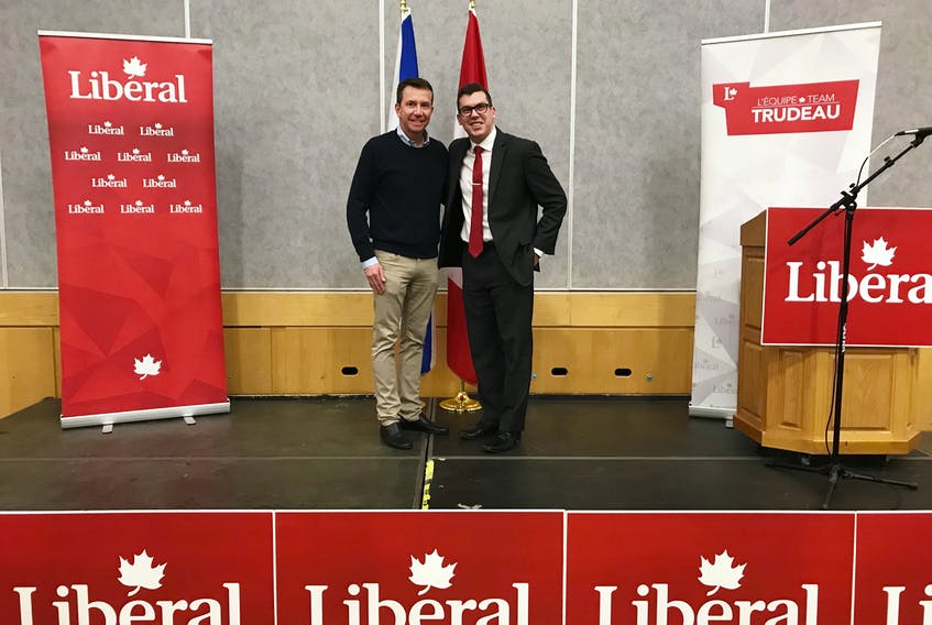 Kody Blois, right, the recently nominated Liberal candidate for Kings-Hants, poses for a photo with former Kings-Hants MP Scott Brison following his nomination on May 11 at Avon View High School.