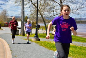 Participants of the fourth annual Lisa's Legacy walk enjoy the beautiful sunshine as they make their way around Lake Pisiquid on May 19, 2019.