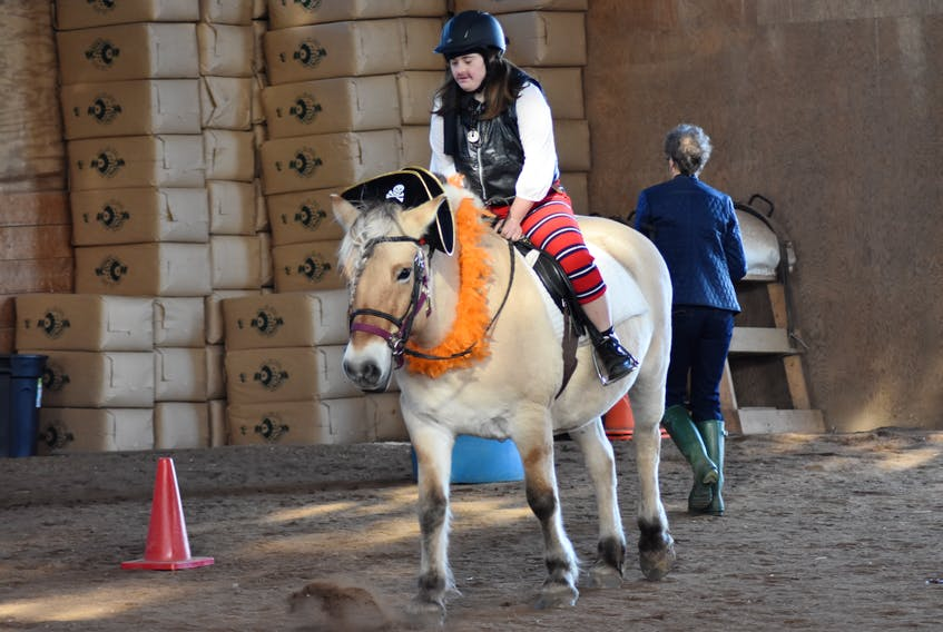 Free Spirit Therapeutic Riding Association rider Hannah Cliche feels right at home with therapy horse Stella. Pictured practicing in the indoor riding ring at Rohan Wood Stables Oct. 31, the duo is dressed as pirates for Halloween.