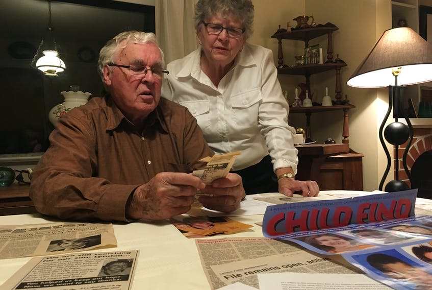 Earle and Betty Fuller comb through missing person posters and newspaper clippings relating to the disappearance of their youngest son, Lyndon Fuller, on Nov. 25, 1988.