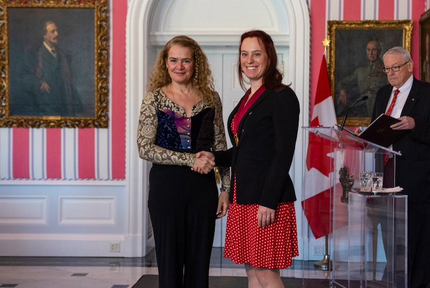 Booker School teacher Temma Frecker shakes hands with Governor General Julie Payette after being presented with the Governor General's History Award for Excellence in Teaching. -- Andrew Workman/Canada's History Society