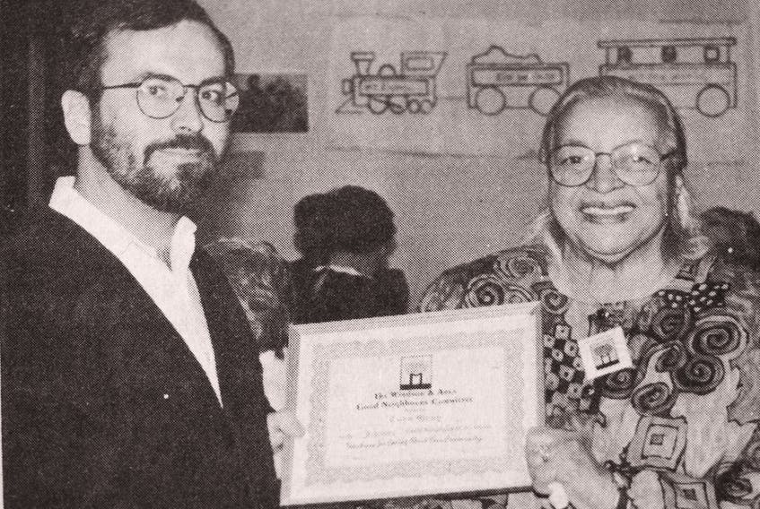 Three Mile Plains' Cora Gray was selected by the Good Neighbours Committee of Windsor and area to be the Good Neighbour for February 1994. Pictured presenting her a certificate is Les Reid, the chairman of the local Good Neighbours branch.