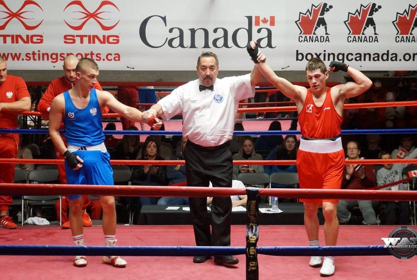 Wyatt Sanford (right) on the Canadian National Boxing Team, is victorious again Poland's Karol Kowal. Team Canada won 10 of 14 bouts during the dual match tournament. - Pierre Lavoie/Way Productions