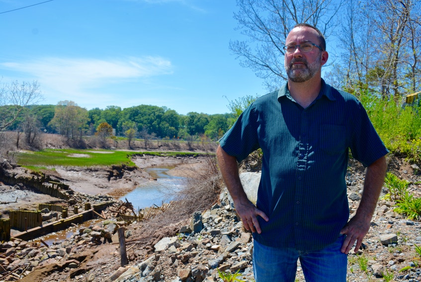 West Hants councillor for Hantsport, Robbie Zwicker, standing near the edge of the Halfway River, said he's concerned about what increased tide waters could do to the surrounding lands.