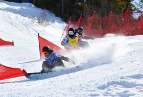 Male competitors, aged 15-19 years, go by a tight corner before crashing.