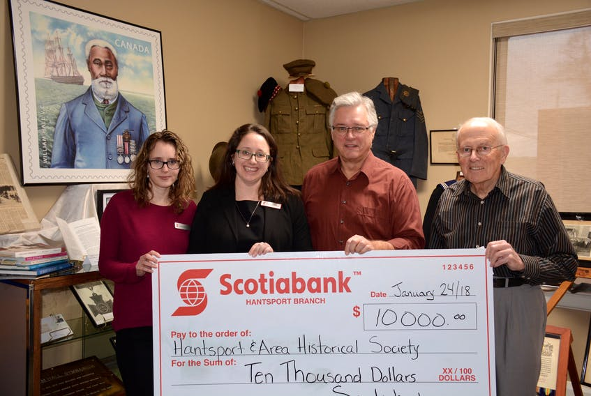 From left, Samantha Goodine and Jessica Poirier, with Scotiabank, present a $10,000 cheque to Jud Porter and Roy Bishop of the Hantsport and Area Historical Society.
