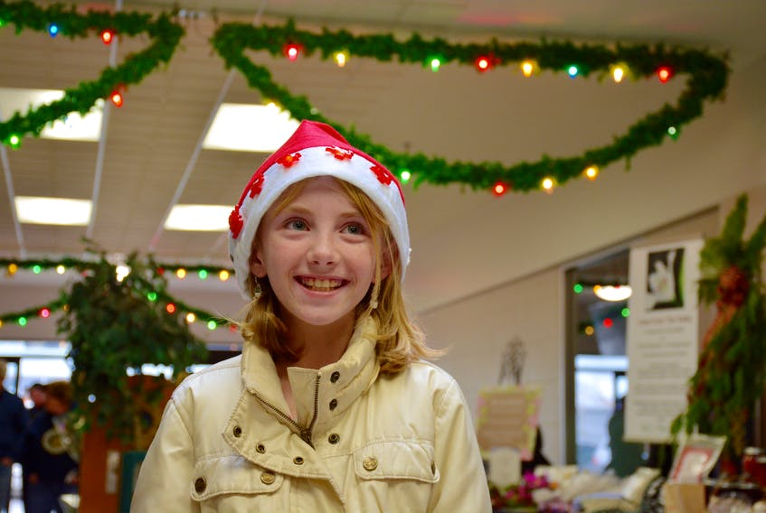 Ashlynn Oickle, 10, said she's also a big fan of Santa Claus, sporting a light up Santa hat of her own.