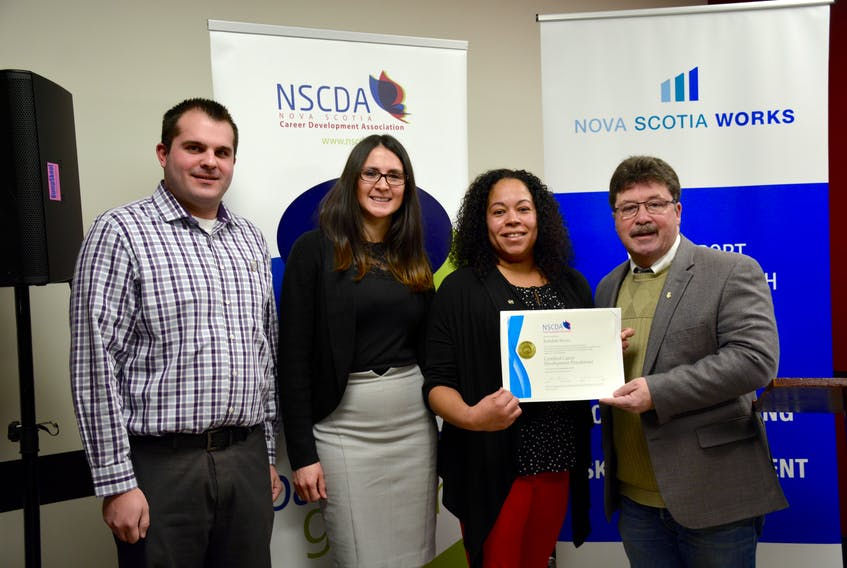 From left Burrell Lyons, the service centre manager with Glooscap First Nation, Catalina Hoffman, a Nova Scotia Works client, Rebekah Skeete, NSCDA certificate recipient, and Hants West MLA Chuck Porter were among those who attended a press conference recognizing the milestones of the Nova Scotia Works program in Windsor.