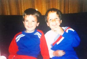 Kevin Martin, left, with his older brother Olin. The two were only 10 months apart in age. Olin tragically died in an accidental house fire and Kevin was later murdered.