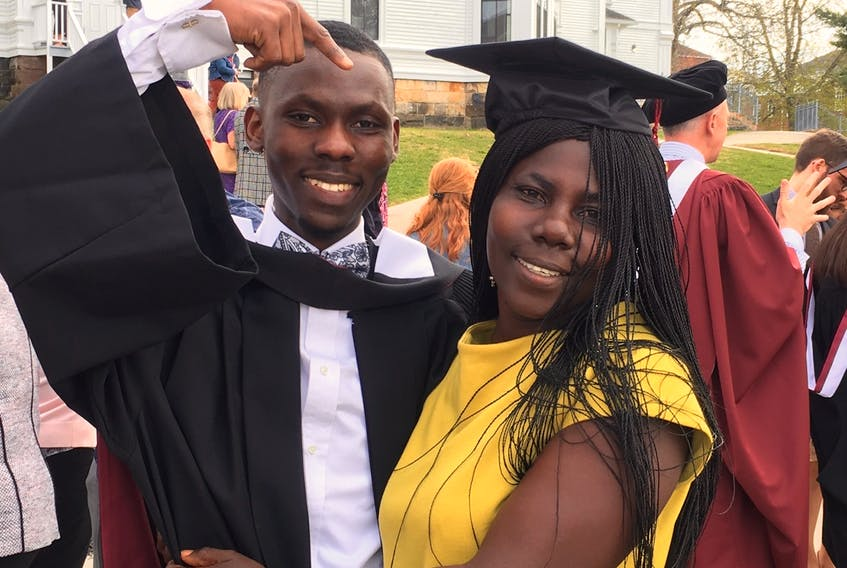 Following an emotional ceremony, Joel Okyere placed his mortarboard on his mother, Charity Amin's head.