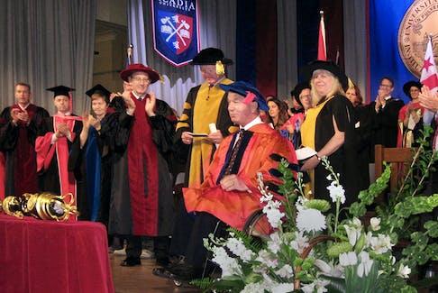 On receiving his Doctor of Humanities from Acadia University, Rick Hansen, Canada's Man in Motion, was applauded warmly. - Wendy Elliott