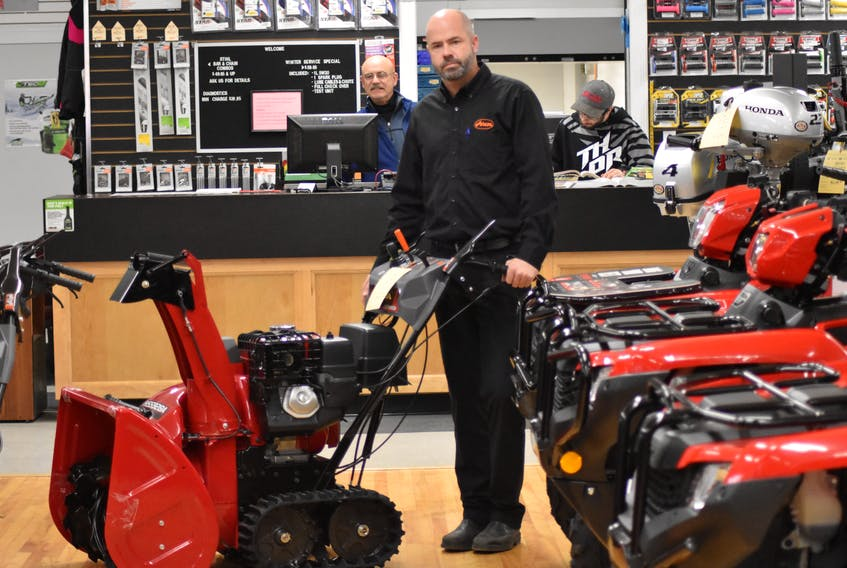 G. W. Sampson Co. Ltd. general manager Matthew Bonnyman showcases an example of what the five snowblowers stolen from the Kingston business recently look like.